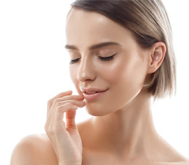 Woman feeling face with hand, eyes closed, smooth skin
