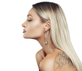 Side view of woman with tattoo on back close to shoulder, eyes closed